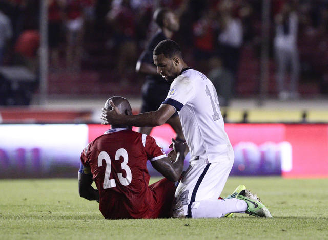 Terrence Boyd of the U.S. talks with Panama's Felipe Baloy after the U.S. defeated Panama in a 2014 World Cup qualifying soccer match in Panama City, Tuesday, Oct. 15, 2013. The United States rall ...
