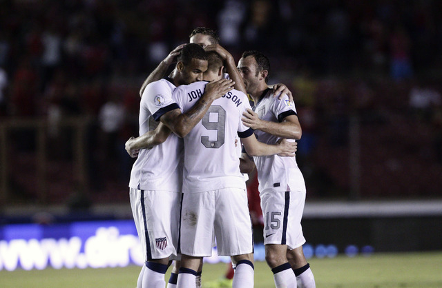 Aron Johannsson, center, of the U.S. celebrates with teammates after scoring a goal against Panama in a 2014 World Cup qualifying soccer match, in Panama City, Tuesday, Oct. 15, 2013. The United S ...