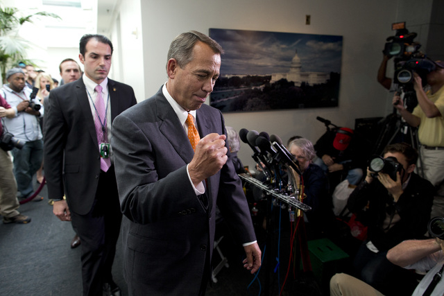 Speaker of the House Rep. John Boehner, R-Ohio, pumps his fist as he walks past reporters after a meeting with House Republicans on Capitol Hill on Wednesday, Oct. 16, 2013 in Washington. The part ...