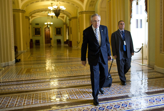 Senate Majority Leader Sen. Harry Reid, D-Nev., walks to his office after arriving on Capitol Hill on Wednesday. Aides to Senate Democrat Majority Leader Harry Reid and Republican Minority Leader  ...