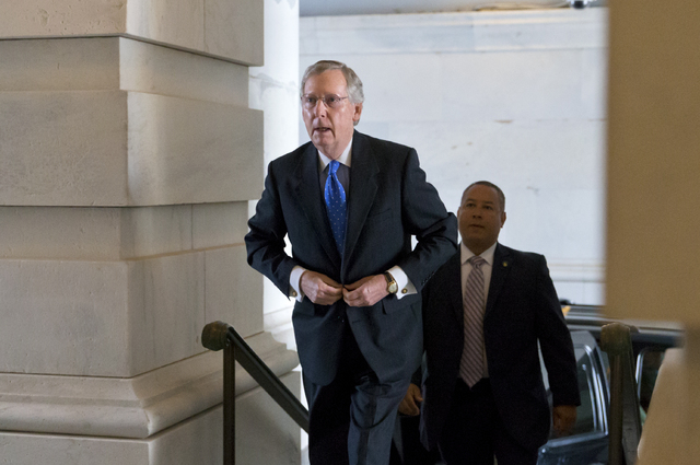Senate Minority Leader Mitch McConnell, R-Ky., arrives at the Capitol in Washington on Wednesday. Aides to Senate Democrat Majority Leader Harry Reid and Republican Minority Leader Mitch McConnell ...