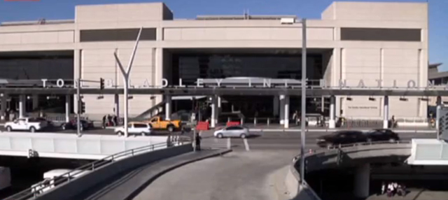 In this framegrabbed image from APTN the entrance to the Tom Bradley International Terminal in Los Angeles can be seen Tuesday Oct. 15, 2013. A baggage handler was arrested Tuesday in connection w ...