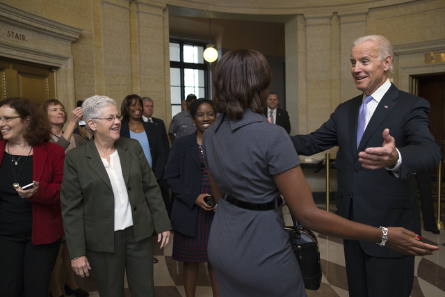 Vice President Joe Biden, right, greets Environmental Protection Agency workers as they return to work after 16 days of a government shutdown at the William Jefferson Clinton Federal Building in W ...