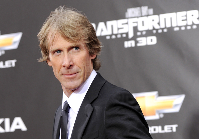 "FILE - In this June 28, 2011 file photo, executive producer and director Michael Bay attends the ""Transformers: Dark Of The Moon"" premiere in Times Square in New York. Filming of Hollywo ..."