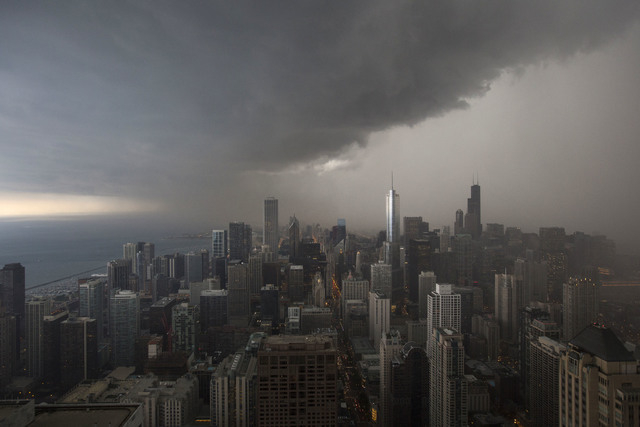 Storm clouds pass over downtown Chicago. The federal government shutdown may have seemed like a frustrating squabble in far-off Washington, but in Chicago, it crept into lives in small, subtle way ...