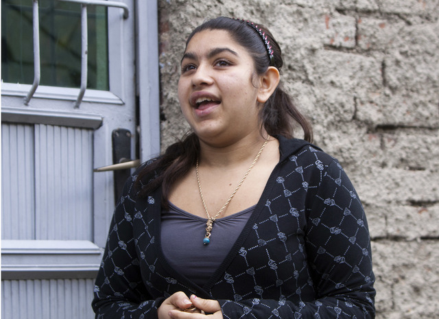 Leonarda Dibrani, 15, expelled from France last week, talks outside a shelter house in the northern town of Mitrovica, Kosovo, Friday Oct. 18, 2013. Leonarda Dibrani, taken by police from a school ...