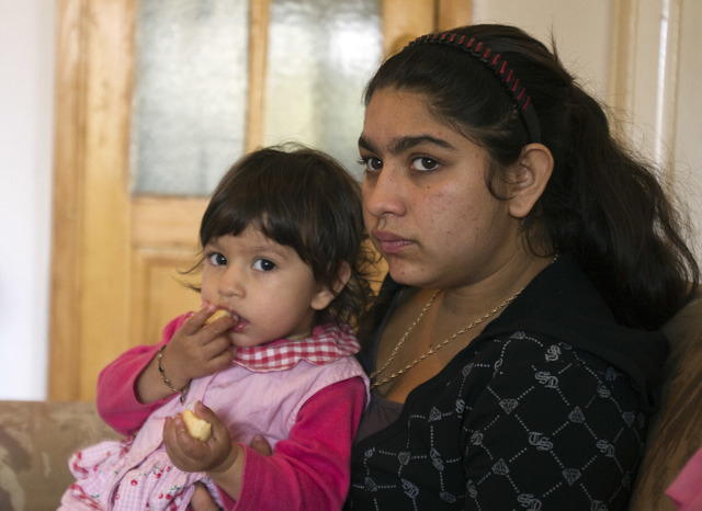 Leonarda Dibrani, 15, expelled from France last week, holds her sister Medina in a shelter house in the northern town of Mitrovica, Kosovo, Friday Oct. 18, 2013. Leonarda Dibrani, taken by police  ...