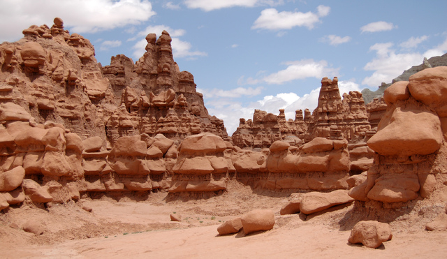 This undated photo released by Utah State Parks shows rock formations at Goblin Valley State Park. Authorities say three men could face felony charges after purposely knocking over an ancient Utah ...