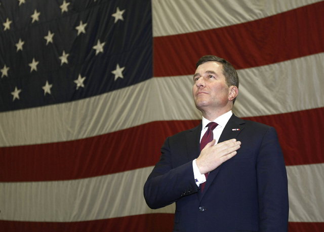 FILE - In this March 8, 2013 file photo, U.S. Ambassador to France Charles H. Rivkin, stands as the US national anthem is played aboard US aircraft carrier USS Dwight D. Eisenhower, in Marseille,  ...