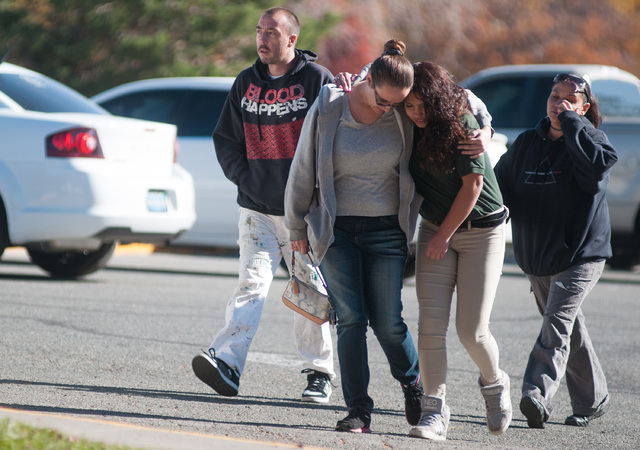 A Sparks Middle School student and her mother walk near Agnes Risley Elementary School,  after students were evacuated to the school after a shooting at Sparks Middle School in Sparks, Nev. on Mon ...
