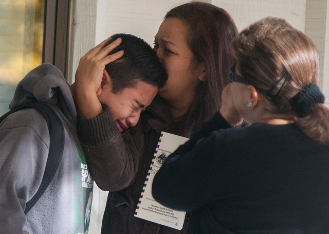 A  Sparks Middle School student cries and is comforted after being released from Agnes Risley Elementary School, where some students were evacuated to after a shooting at SMS in Sparks, Nev. on Mo ...