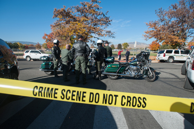Police secure the scene near Sparks Middle School after a shooting in Sparks, Nev., on Monday, Oct. 21, 2013.  Authorities are reporting that two people were killed and two wounded at the Nevada m ...