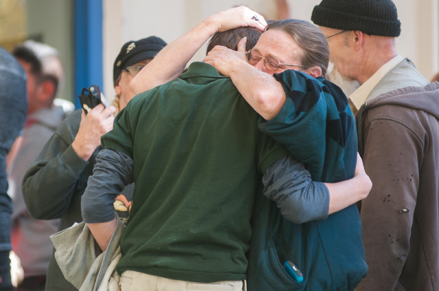 A  Sparks Middle School student cries with family members after being released from Agnes Risley Elementary School, where some students were evacuated to after a shooting at Sparks Middle School i ...