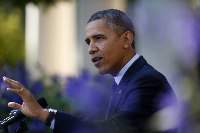 President Barack Obama gestures while speaking in the Rose Garden of the White House in Washington, Monday, Oct. 21, 2013, on the initial rollout of the health care overhaul. Obama acknowledged th ...