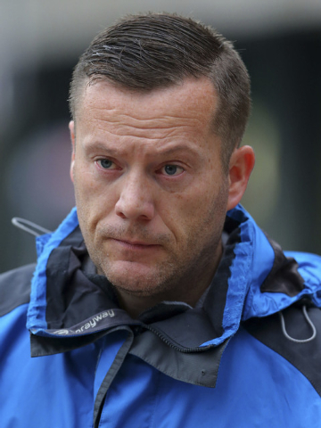 Neil McArdle arrives at Liverpool Crown Court Tuesday Oct. 22, 2013, to be sentenced after he pleaded guilty to communicating false information with intent, after he made a phone call to St. Georg ...