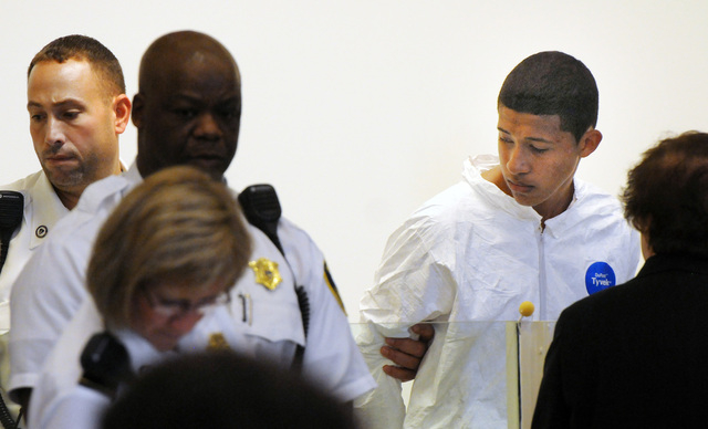 Philip Chism, 14, right, stands during his arraignment for the death of Danvers High School teacher Colleen Ritzer in Salem District Court in Salem, Mass. on Wednesday. Chism has been ordered held ...