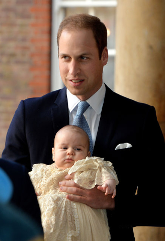 Britain's Prince William, holds his son Prince George as they arrive at Chapel Royal in St. James's Palace in London, for the christening of the 3-month-old Prince on Wednesday. (AP Photo/John Sti ...