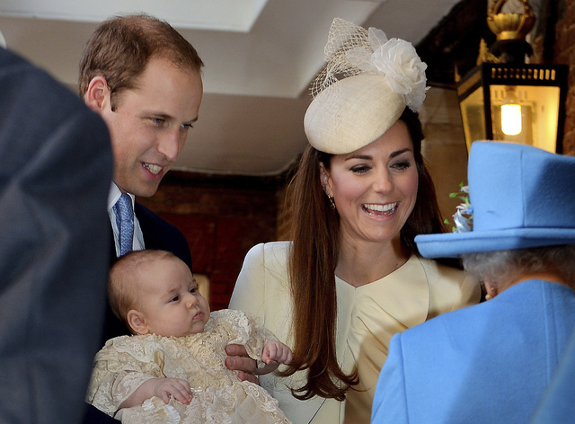 Britain's Queen Elizabeth II, right,  speaks with Prince William and Kate Duchess of Cambridge as they arrive with their son, Prince George, at the Chapel Royal in St. James's Palace on Wednesday. ...