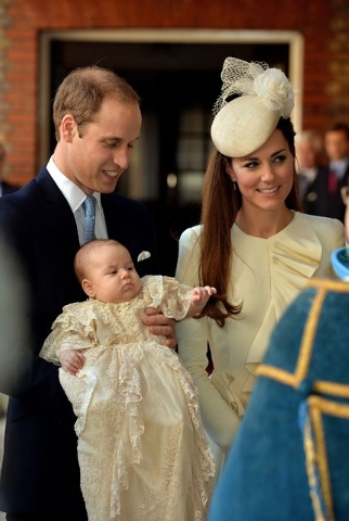 Britain's Prince William and Kate Duchess of Cambridge, with their son, Prince George, arrive at Chapel Royal in St. James's Palace in London for the christening of the 3-month-old on Wednesday.   ...