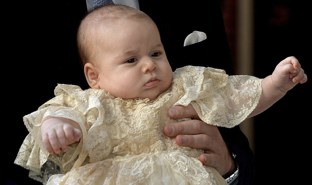 Britain's Prince George is held by his father Prince William as they arrive at Chapel Royal in St. James's Palace in London, for the christening of the 3-month-old Prince on Wednesday. (AP Photo/J ...