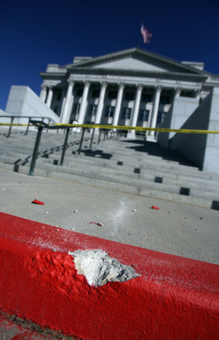 Francisco Kjolseth  |  The Salt Lake Tribune The curb is chipped where a man drove up the steps in the background to the west entrance to the Utah State Capitol in Salt Lake City Tuesday Oct. 22,  ...