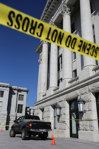 A truck sits behind crime scene tape after being driven up several flights of stairs to the west entrance of the Utah State Capitol on Tuesday Oct. 22, 2013.   Utah state troopers used a stun gun  ...