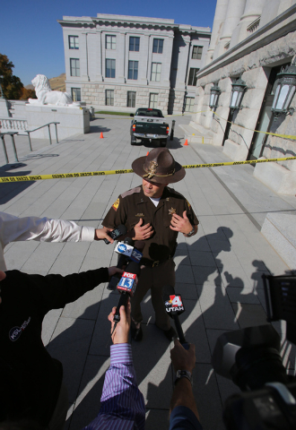 Utah Highway Patrol Captain Barton Blair discusses an incident where a man reportedly was shocked with a stun gun after driving a truck, in background, up several flights of stairs to the West ent ...