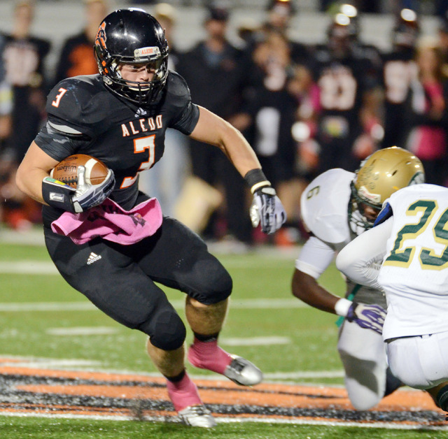 In this Oct. 18, 2013, photo, Aledo's Daythan Davis, left,  runs past Western Hills Jacoby Powell (6) , and Desmond Mize as he races for a first down in the first quarter of a football game in Ale ...