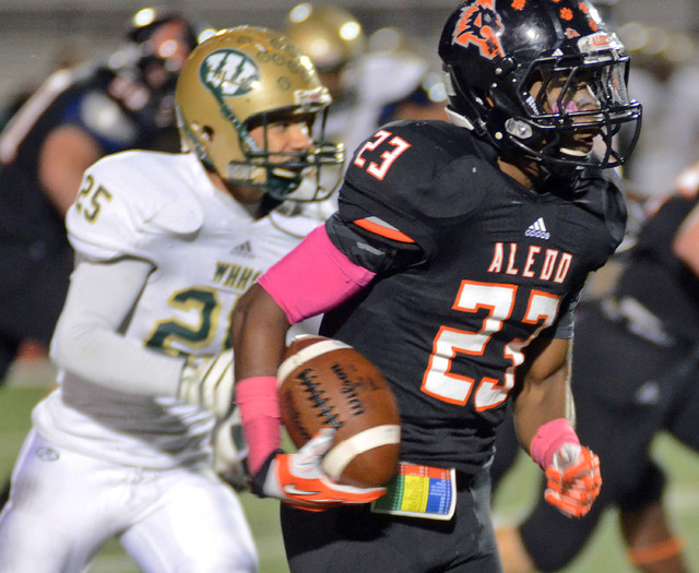In this Oct. 18, 2013, photo, Aledo's Jess Anders races past Western Hills's Desmond Mize to score the touchdown during the second quarter of  of a football game in Aledo, Texas. Aledo defeated We ...