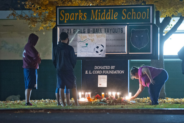 Community members gather to pay their respects to Michael Landsberry, a 45-year-old eighth-grade math teacher, soccer coach and former Marine who was killed by an eighth-grader at Sparks Middle Sc ...