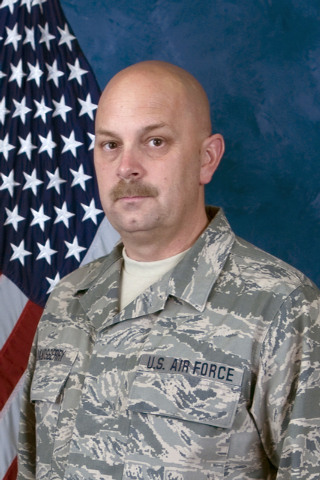 This undated photo released by the Nevada Air National Guard shows Sparks Middle school math teacher and former Marine Michael Landsberry, 45. Authorities say the student who opened fire on a the  ...