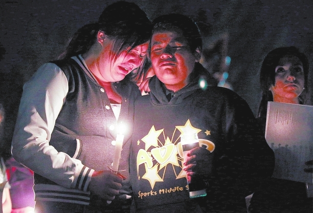 Jeannette Vasquez, 14, and Carlos Lara, 13, were among hundreds of students and residents who attended a candlelight vigil at Sparks Middle School in Sparks, Nev., on Wednesday, Oct. 23, 2013, in  ...