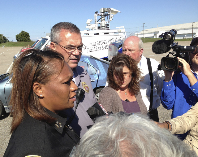 Police Chief Rita Stanback and Fire Chief Gary Graves, second from left, of Millington, Tenn., brief reporters about a shooting near a U.S. Naval Support Activity Mid-South on Thursday, Oct. 24, 2 ...