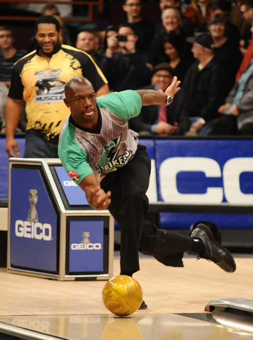 Former NFL football player Terrell  Owens bowls during the PBA Detroit Winter Swing at Thunderbowl Lanes in Allen Park, Mich. Owens has finally found a sport where he doesn't have to worry about g ...