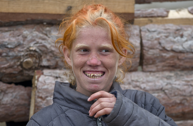 Minka Ruseva, daughter of Sasha Ruseva, left, laughs in a Roma neighborhood of Nikolaevo, Bulgaria, Friday, Oct. 25, 2013. Sasha Ruseva, a Bulgarian Roma woman from this town, is under investigati ...