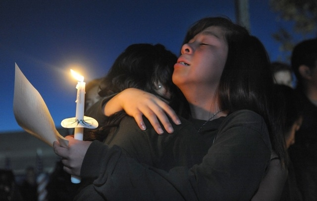 Jannelle Tan grieves for her teacher Michael Landsberry during a vigil held at Sparks Middle School on Wednesday, Oct. 23, 2013 in Sparks, Nev.  Monday's shooting left Landsberry dead and two stud ...