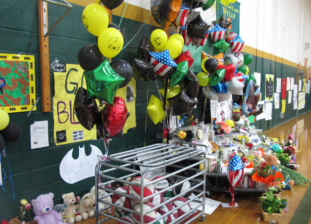 This photo shows a memorial to fallen teacher Michael Landsberry that Sparks Middle School officials moved inside the gymnasium on Thursday, Oct. 24, 2014, in Sparks, Nev. Students are to return t ...
