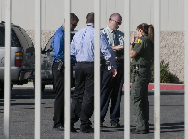San Bernardino County Sheriff's Homicide Division detectives and scientific investigations workers meet at the Materials Recycling Facility in Victorville, Calif., on Thursday, Oct. 24, 2013. Auth ...
