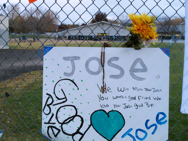 Students return to Sparks Middle School on Monday morning, Oct. 28, 2013, for the first time since Oct. 21, when a 12-year-old student gunned down a teacher and wounded two classmates before killi ...