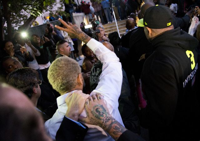 Singer Chris Brownwaves to fans as he departs the H. Carl Moultriel courthouse Monday, Oct. 28, 2013, in Washington. A charge against the Grammy Award-winning R&B singer has been reduced to a misd ...