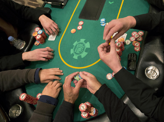 Poker players place their bets during a hand of Texas Hold 'em on Feb. 27 at the poker room at Caesar's Palace in Las Vegas. Casino companies write off tens of millions of dollars in bad debt each ...