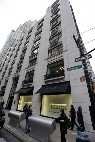 Pedestrians pass Barneys New York department store Monday, Oct. 28, 2013, in New York. The scenario usually involves suspicious glances, inattentive clerks or rude service _ not handcuffs. Yet whe ...