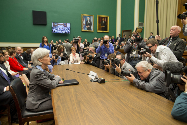 Health and Human Services Secretary Kathleen Sebelius is surrounded by photographers on Capitol Hill in Washington on Wednesday prior to testifying before the House Energy and Commerce Committee h ...