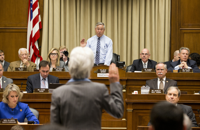 Health and Human Services Secretary Kathleen Sebelius is sworn in on Capitol Hill in Washington on Wednesday by House Energy and Commerce Committee Chairman Rep. Fred Upton, R-Mich., prior to test ...