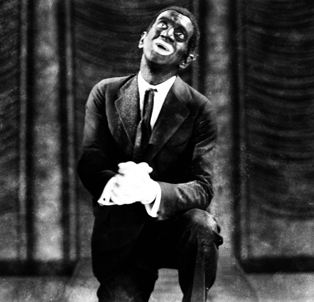 "FILE - This 1927 image originally released by Warner Bros., shows Al Jolson in blackface makeup in the movie ""The Jazz Singer.""  Historically, blackface emerged in the mid-19th century,  ..."