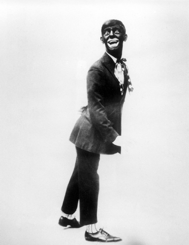"This 1920s image shows comedian Eddie Cantor wearing blackface while performing ""If You Knew Susie."" Historically, blackface emerged in the mid-19th century, representing a combination o ..."
