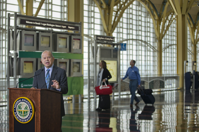 Federal Aviation Administration (FAA) Administrator Michael Huerta announces that government safety rules are changing to let airline passengers use most electronic devices from gate-to-gate durin ...