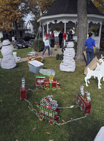 In this Oct. 28, 2013 photo, Adams Street Park in Port Clinton, Ohio is decorated early for Christmas by volunteers for DEvin Kohlman. Kohlman, an eighth-grader who has been battling an aggressive ...