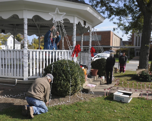 In this Oct. 28, 2013 photo, members of the community gather decorate Adams Street Park in Port Clinton, Ohio, for Devin Kohlman. Kohlman, an eighth-grader who has been battling an aggressive form ...