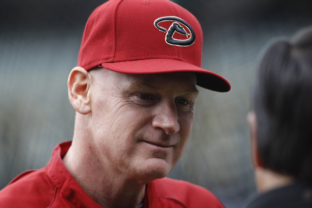 Arizona Diamondbacks third base coach Matt Williams chats with William Geivett, assistant general manager of the Colorado Rockies, before the first inning of a Major League Baseball game in Denver ...